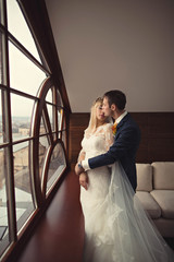 married young  couple rests in hotel  before ceremony
