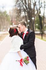 Winter wedding. Bride and groom outdoor.