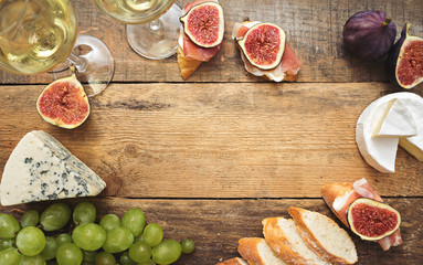 wine and snacks on wooden table