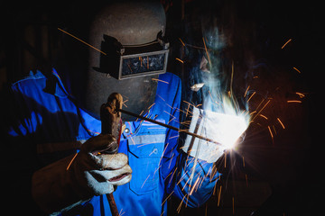Welding steel structures and bright sparks in construction industry