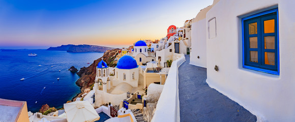 Door stickers Santorini Amazing wide panorama sunset view with white houses on church wi