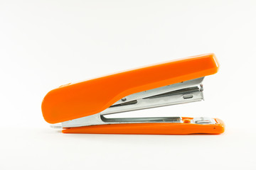 Orange stapler on white background isolated.