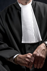 Lawyer in gown with jabot hands close up judge