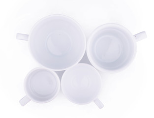 many white coffee porcelain cups isolated