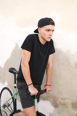 Teen boy with a fixie bicycle