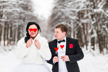 Wedding couple posing with mask. concept of Valentine's Day
