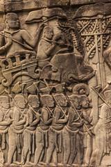 Bas-reliefs with war scenes in Bayon temple, Angkor, Cambodia