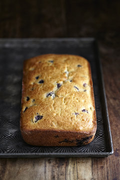 Close-up of blueberry bread in baking tray on wooden table