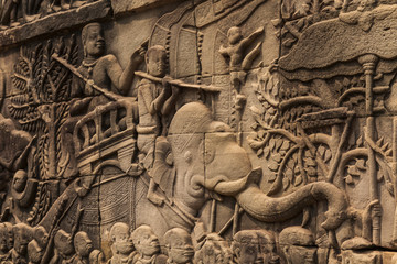 Bas-reliefs with war scenes in Bayon temple, Angkor, Cambodia