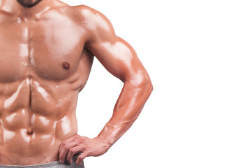 Young man with muscular torso, isolated on white background