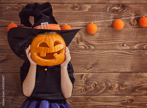 little witch with a pumpkin
