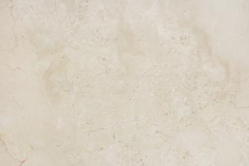 Beautiful beige marble stone wall background.