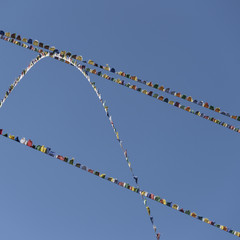 Buddhist prayer flags at Taktsang Palphug Monastery, Bhutan.