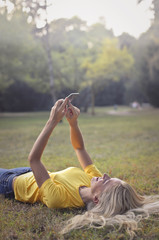 Using a smartphone while lying on the grass