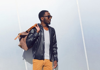 Wall Mural - Fashion portrait elegant african man wearing a sunglasses and bl