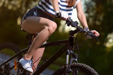 hands on the bike wheel closeup