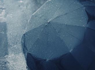 Rain, autumn, weather concept - rainy day, wet umbrella