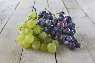 Grapes on wooden table.