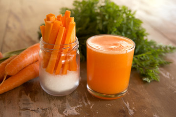 Carrots juice and sticks appetizers. Healthy vegan food. Rich in carotene and vitamin a.