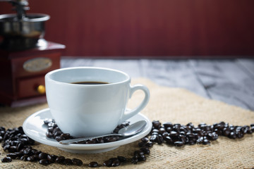 Coffee cup and beans on a rustic background. Coffee Espresso and