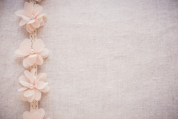 Flowers and lace on linen, copy space toning vintage wedding background