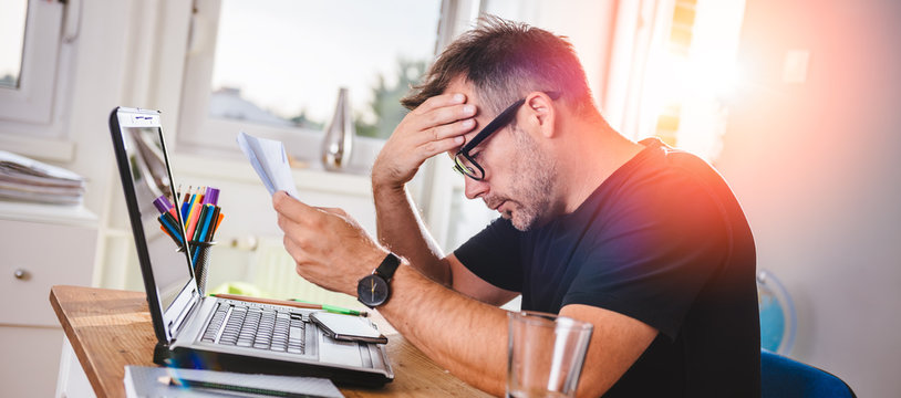 Man reading letter and felling worried