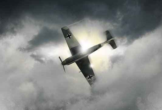 An illustration of a World War 2 German fighter plane as it dives through the clouds. (Computer art, oil style illustration)