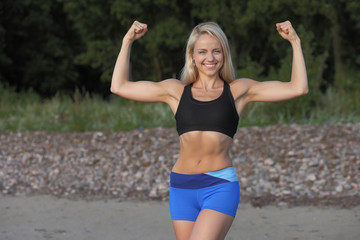 Motivated woman fitness exercising at beach