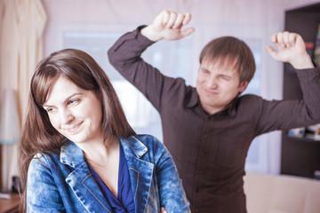 Family Violence Concepts. Young Caucasian Couple Quarrel Indoors