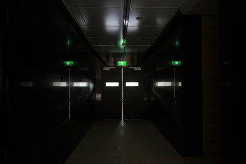 Emergency Exit with Exit Sign. Dark tone concept
