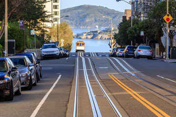 A view of a cable car cresting a hill in San Francisco