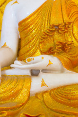 close up hand of Buddha white mable statue in Myanmar style