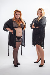 Two young, attractive women in bathrobe with blond and red hair