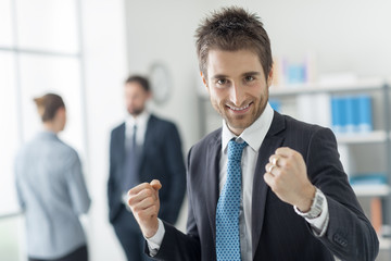 Cheerful businessman with raised fists