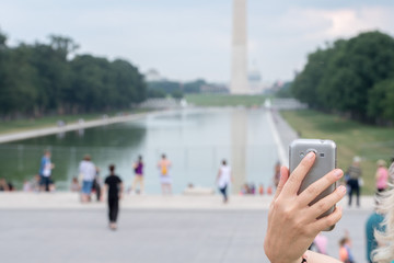selfie remote on cellular phone at Washington Monument Obelisk