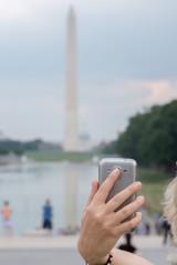 selfie remote on cellular phone at Washington Monument Obelisk