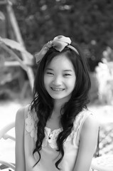 young asian chinese woman smiling  in white dress with iron brac