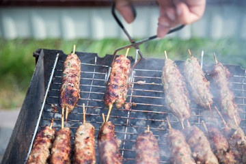 Cooking of lula kebab on the grill at picnic