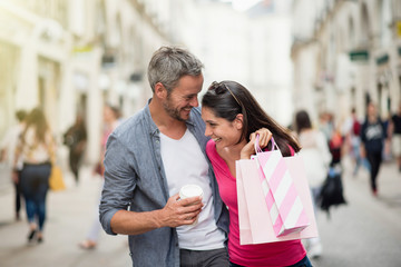 A trendy couple walking and doing shopping in the streets