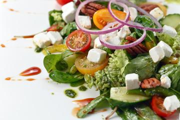 salad with pesto sauce and mozzarella