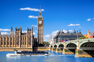 Wall Mural - Big Ben and Houses of Parliament with boat in London, UK
