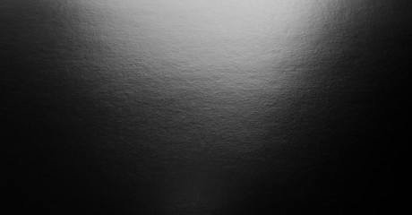 Abstract black background with spotlight