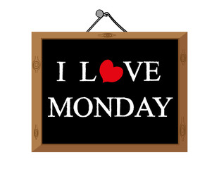 The words I Love Monday in white text with a red heart shape on a blackboard as a concept for job satisfaction and motivation