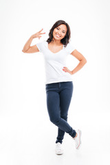 Happy young asian woman showing two fingers or victory gesture