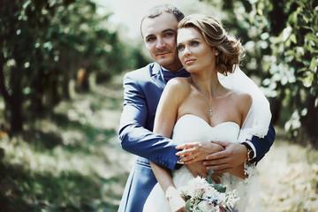 Beautiful couple of happy stylish newlyweds