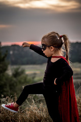 little girl in the image of a super hero