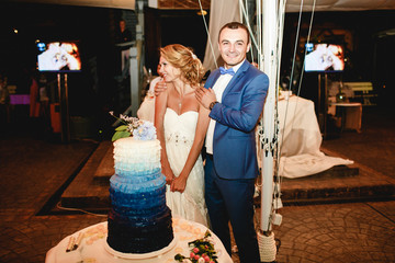 Stylish smilind happy bride and groom