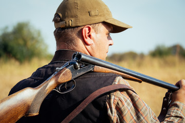 Hunter With Open Shotgun On Shoulder Wall mural
