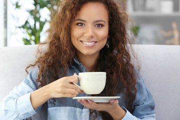 Portrait of beautiful African girl American with coffee