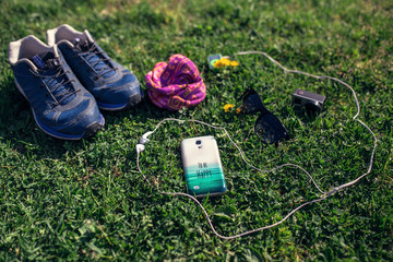 Summer still life on a grass. Active life accessories - running